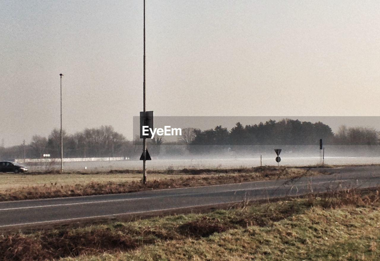 transportation, fog, no people, day, rail transportation, outdoors, grass, railroad track, landscape, tree, sky, nature