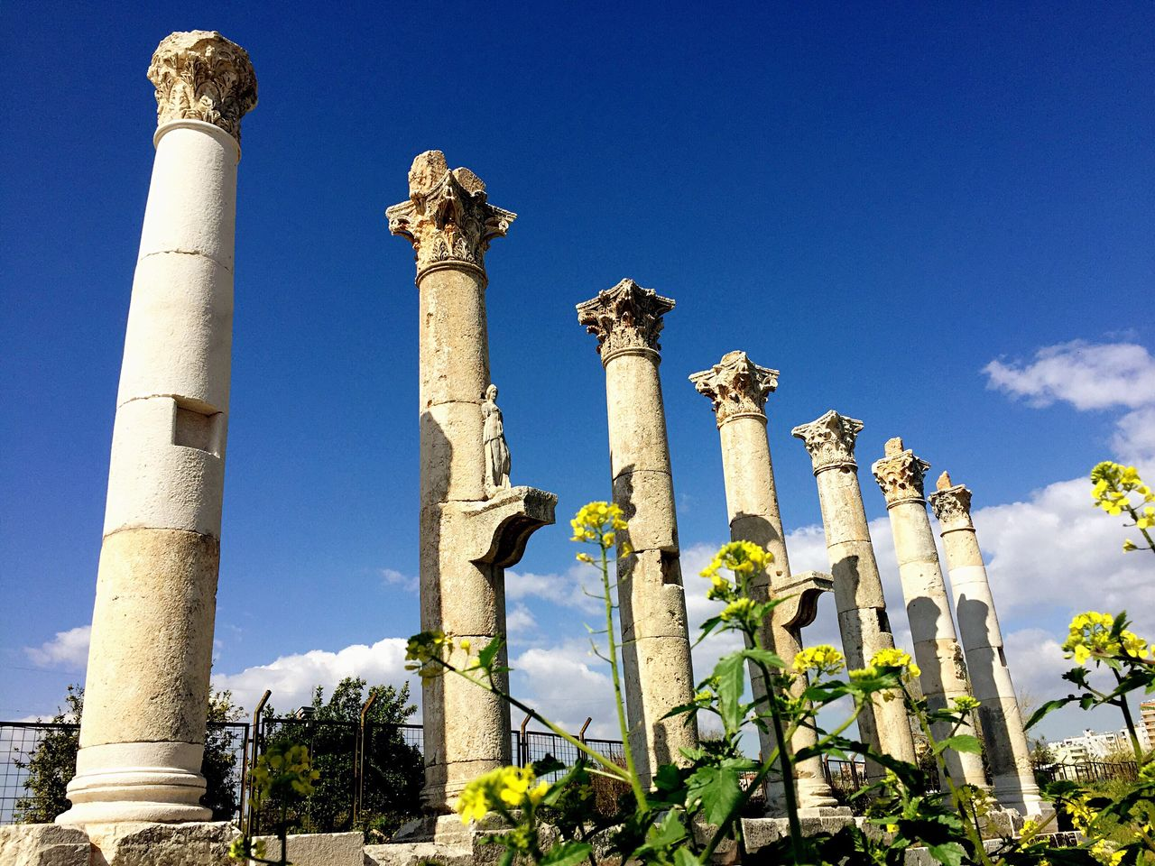 Low angle view of old ruins against blue sky