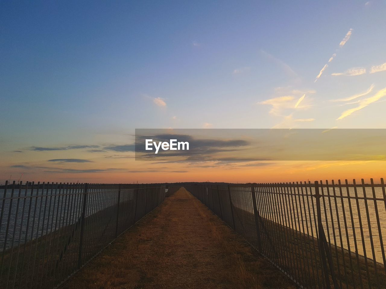 sky, sunset, the way forward, direction, beauty in nature, tranquil scene, nature, tranquility, scenics - nature, cloud - sky, connection, diminishing perspective, fence, railing, water, barrier, sea, no people, protection, outdoors
