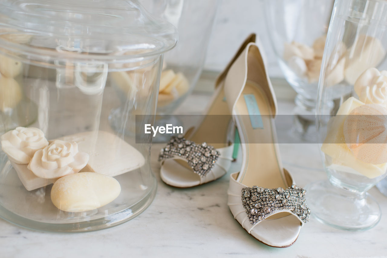 Close-up of sandal on table