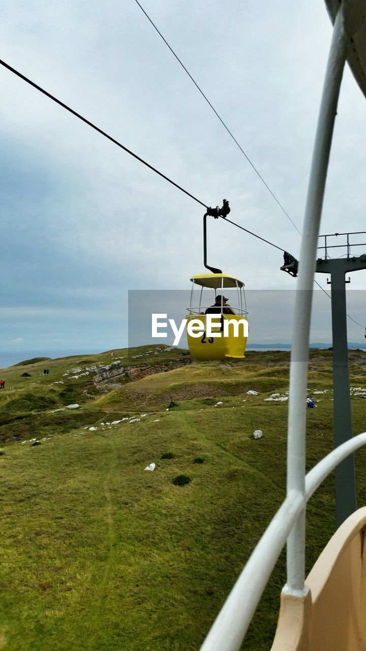 cable, transportation, mode of transport, nature, overhead cable car, sky, day, outdoors, landscape, no people, beauty in nature, grass, scenics, ski lift