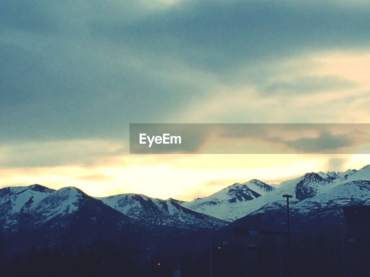 cold temperature, snow, mountain, winter, sky, nature, weather, outdoors, cloud - sky, beauty in nature, sunset, scenics, no people, tranquility, landscape, day