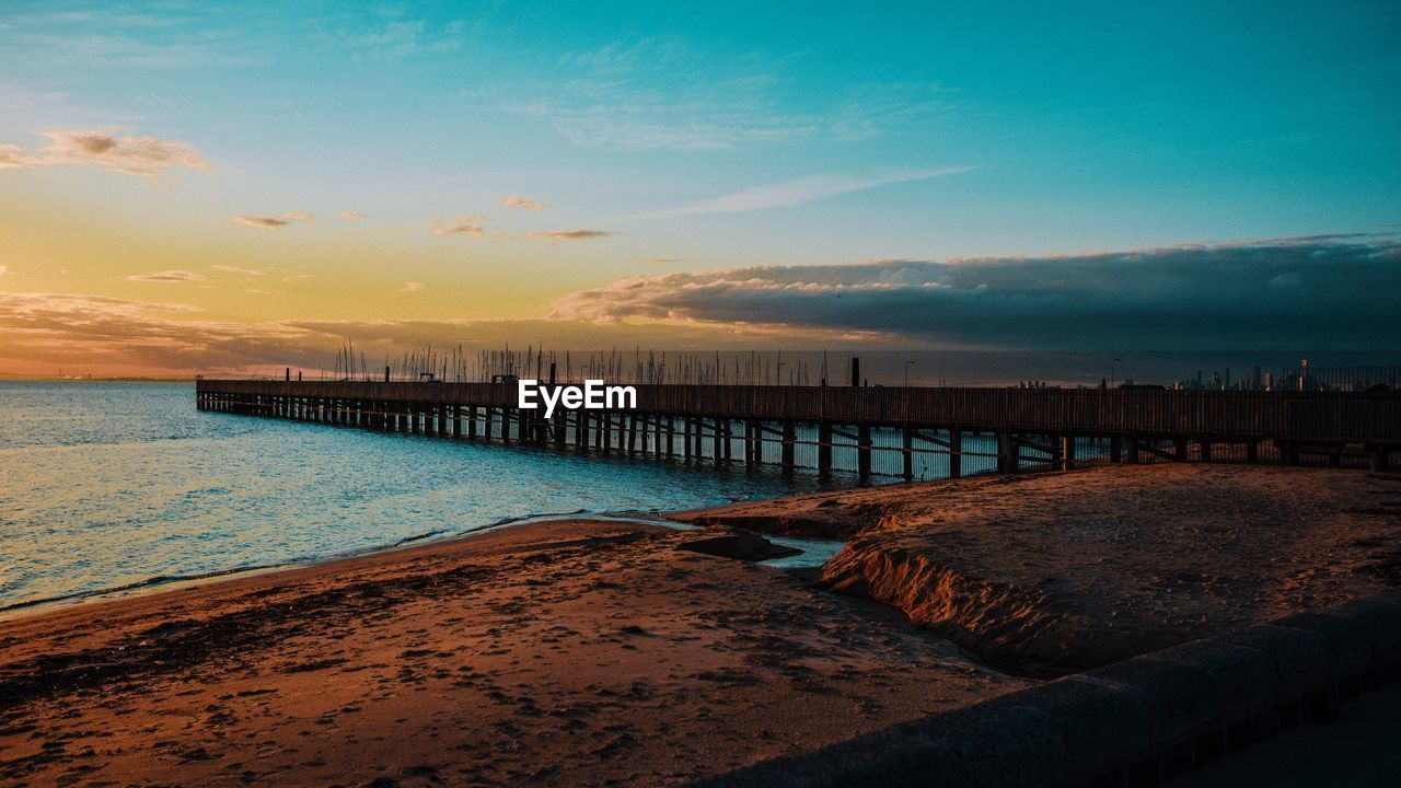 water, sky, sea, sunset, cloud - sky, scenics - nature, beauty in nature, beach, tranquil scene, pier, land, tranquility, nature, horizon over water, no people, horizon, idyllic, wood - material, architecture, outdoors, wooden post