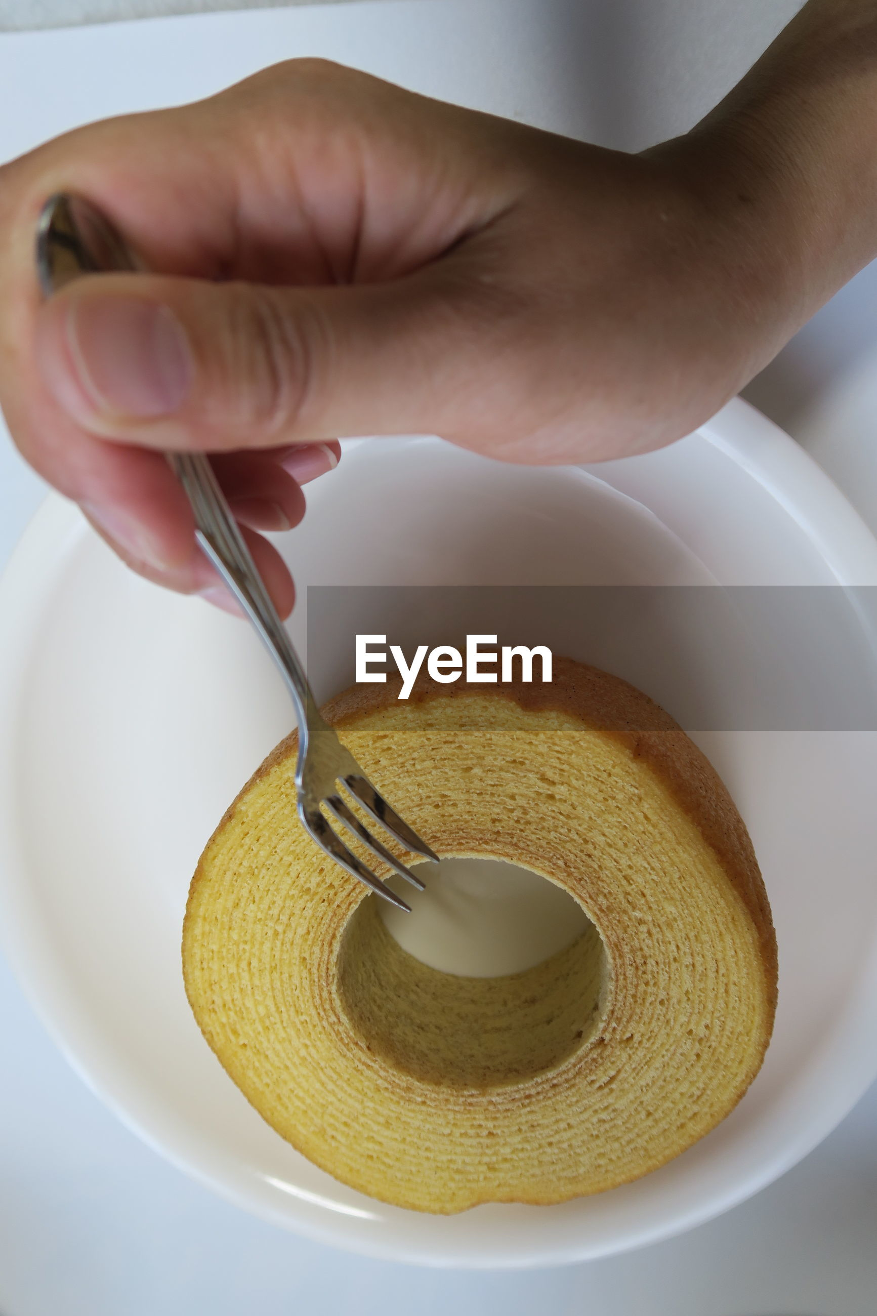 CROPPED IMAGE OF PERSON HAVING BREAKFAST
