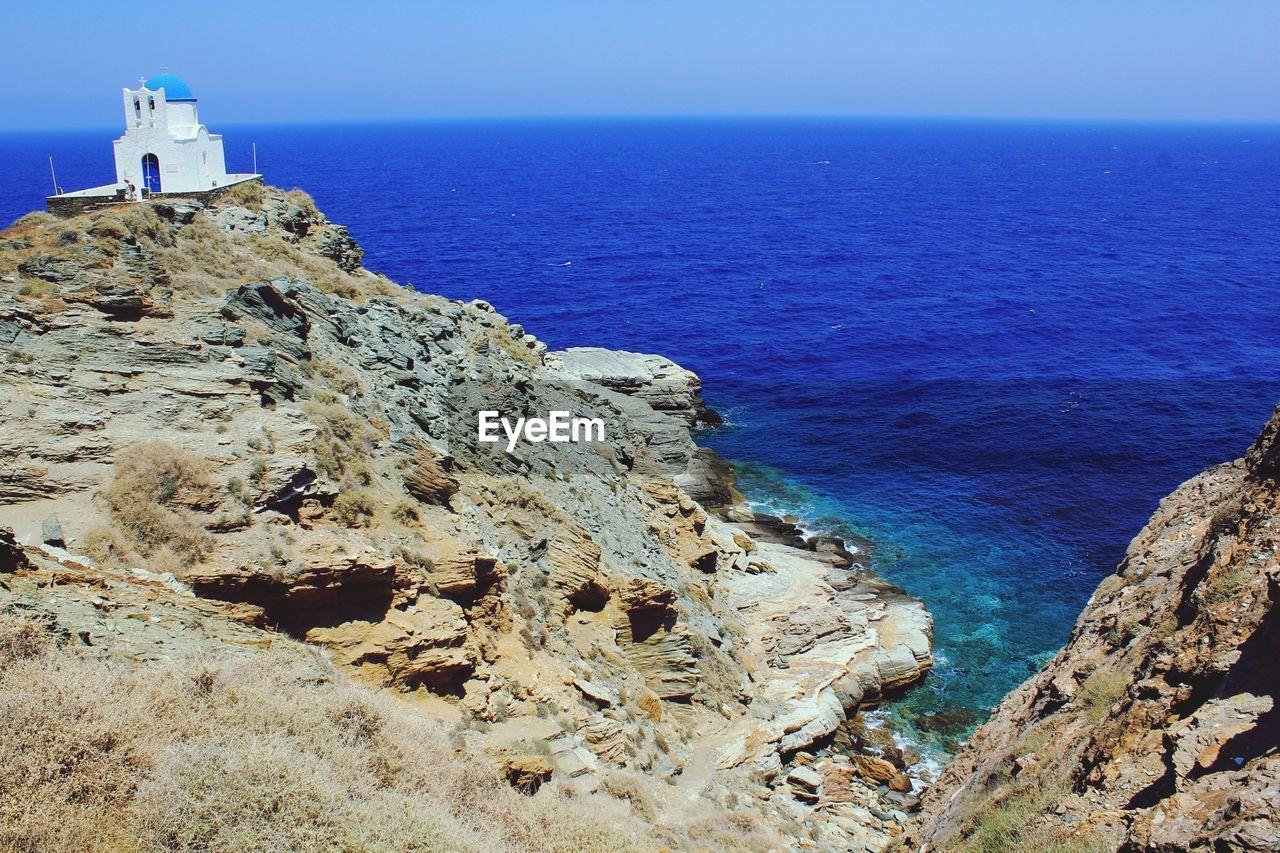 Chapel On Rock Formation In Blue Sea