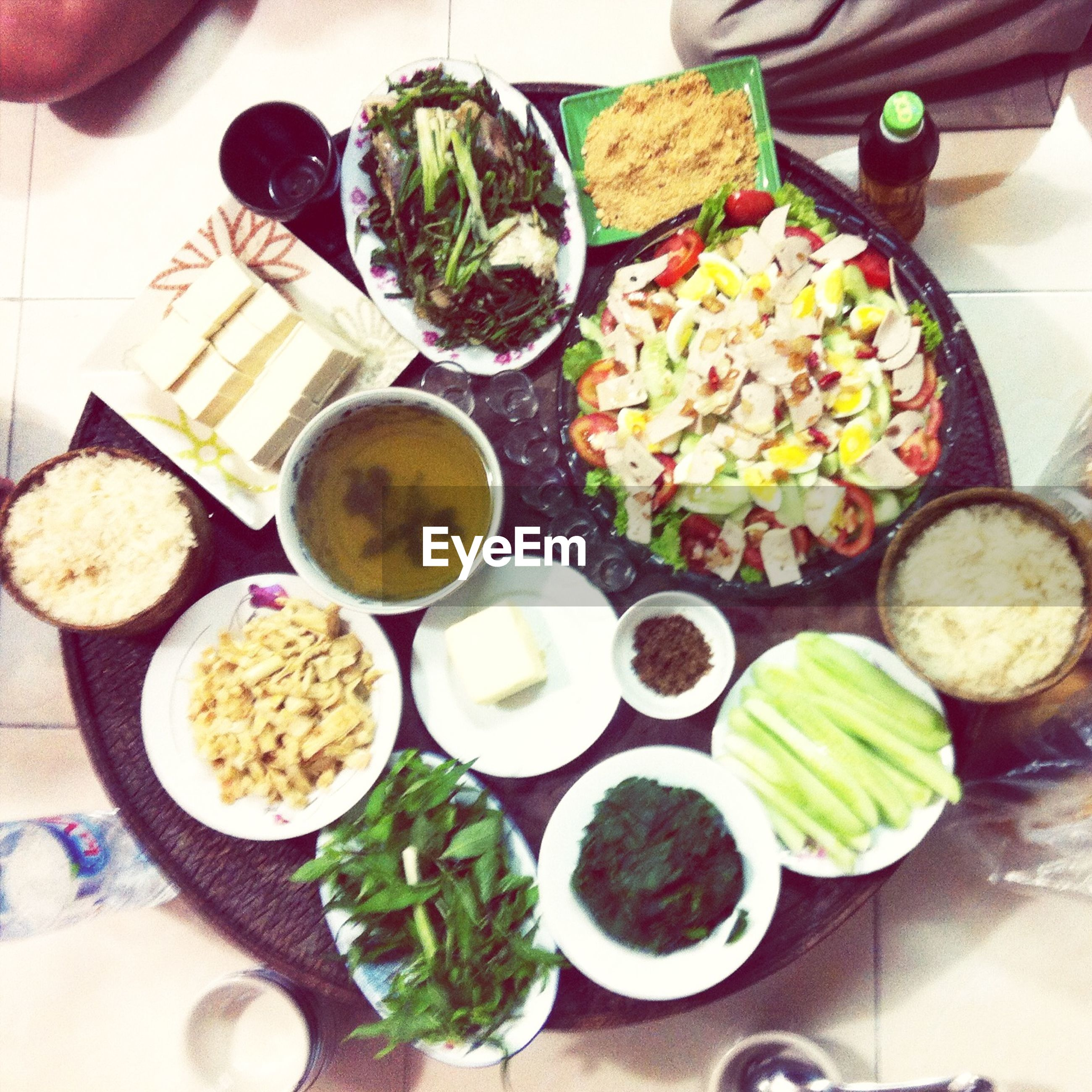 food and drink, freshness, food, healthy eating, indoors, table, high angle view, vegetable, variation, bowl, still life, salad, plate, ready-to-eat, directly above, meal, choice, no people, ingredient, lemon