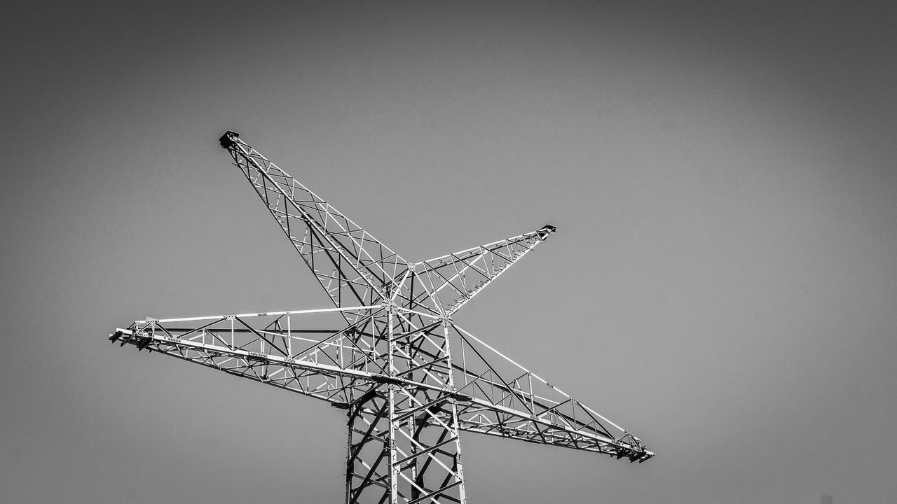 sky, clear sky, copy space, nature, low angle view, no people, day, outdoors, metal, tall - high, crane - construction machinery, machinery, fuel and power generation, renewable energy, development, architecture, industry, environment, alternative energy, built structure