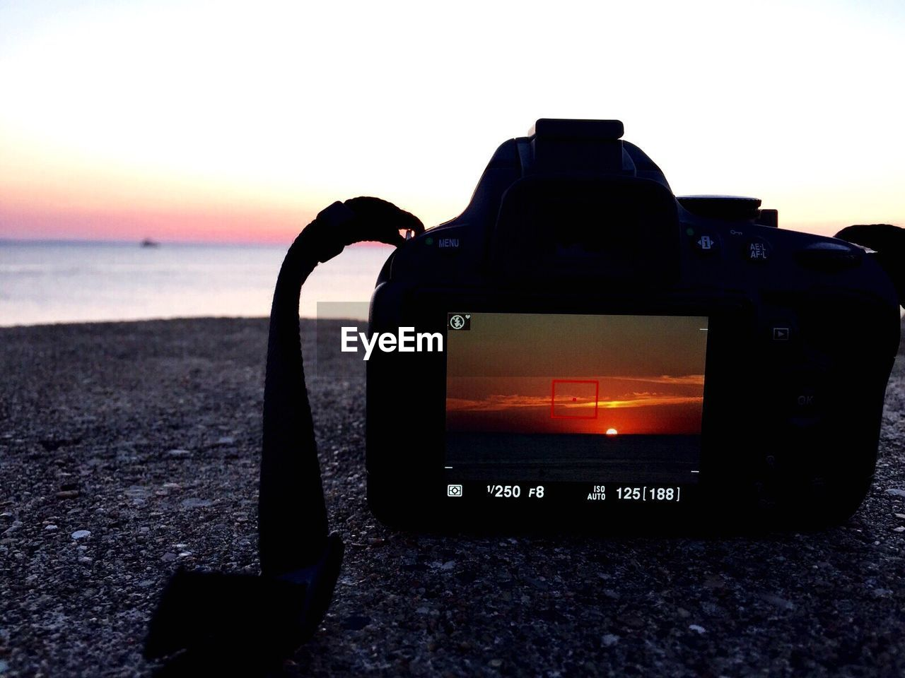sea, beach, silhouette, no people, photography themes, sunset, technology, horizon over water, sky, camera - photographic equipment, communication, outdoors, water, close-up, wireless technology, beauty in nature, nature, digital single-lens reflex camera, day