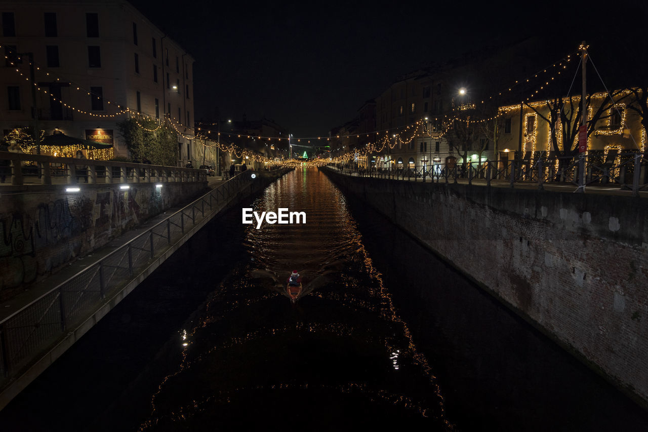 illuminated, architecture, night, built structure, building exterior, city, connection, water, bridge, the way forward, nature, direction, diminishing perspective, bridge - man made structure, sky, transportation, lighting equipment, outdoors, incidental people, canal