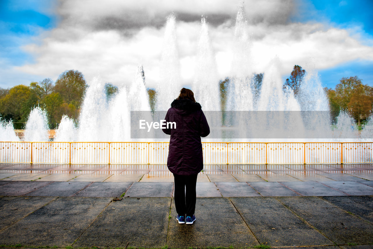 Rear View Of Woman Standing By Fountains At Battersea Park