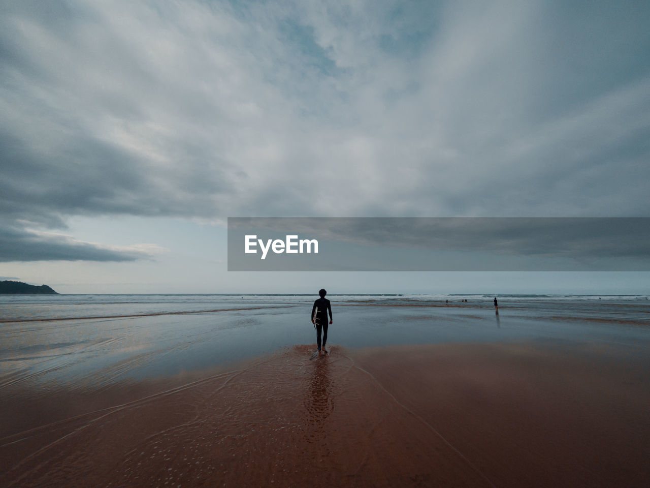 sky, sea, cloud - sky, water, real people, beauty in nature, land, beach, horizon over water, rear view, scenics - nature, horizon, one person, standing, nature, full length, lifestyles, tranquil scene, tranquility, looking at view