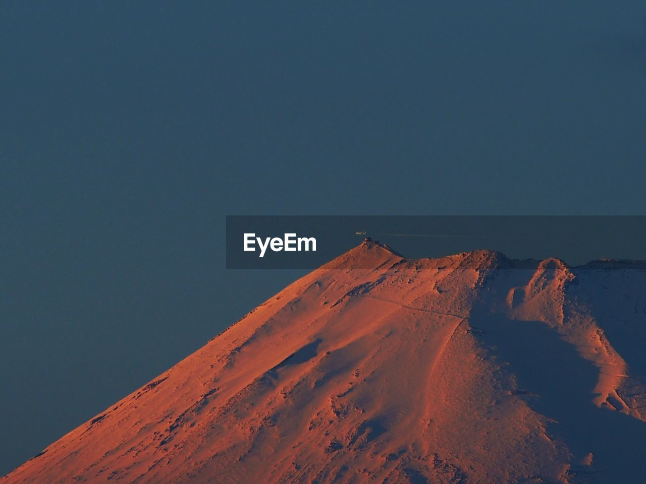 Low Angle View Of Mountain At Sunset