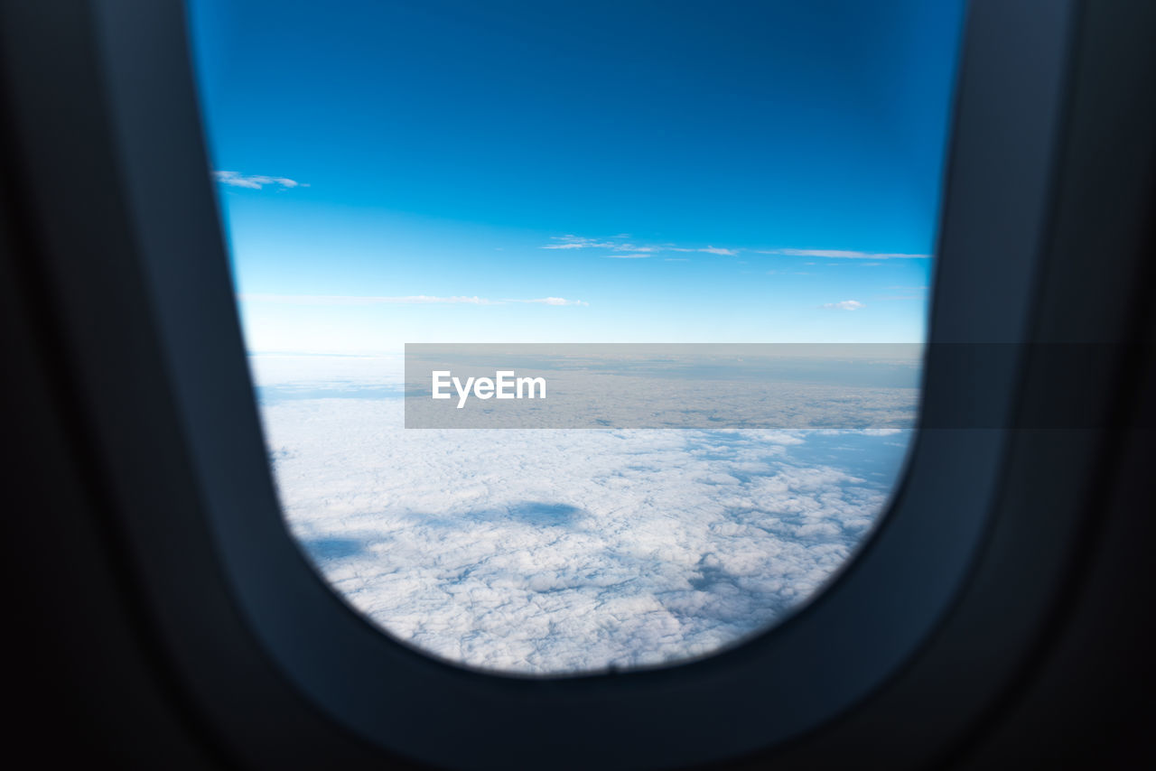 Scenic View Of Cloudscape Seen Through Airplane Window