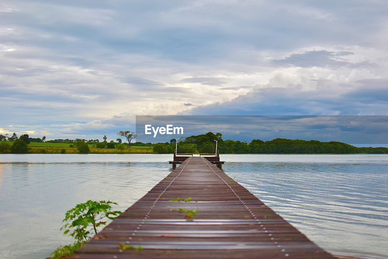 cloud - sky, sky, water, beauty in nature, nature, direction, the way forward, day, tranquil scene, wood - material, tranquility, pier, scenics - nature, no people, lake, outdoors, plant, idyllic, non-urban scene, long, wood paneling