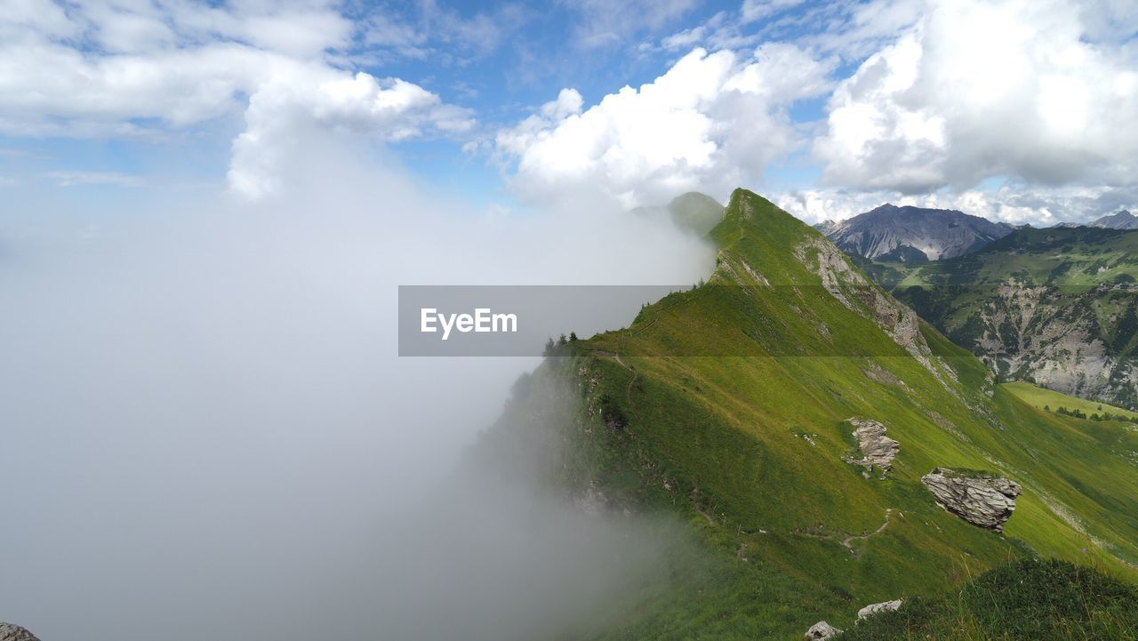 sky, mountain, beauty in nature, nature, cloud - sky, tranquil scene, scenics, day, tranquility, outdoors, landscape, no people, mountain range, grass