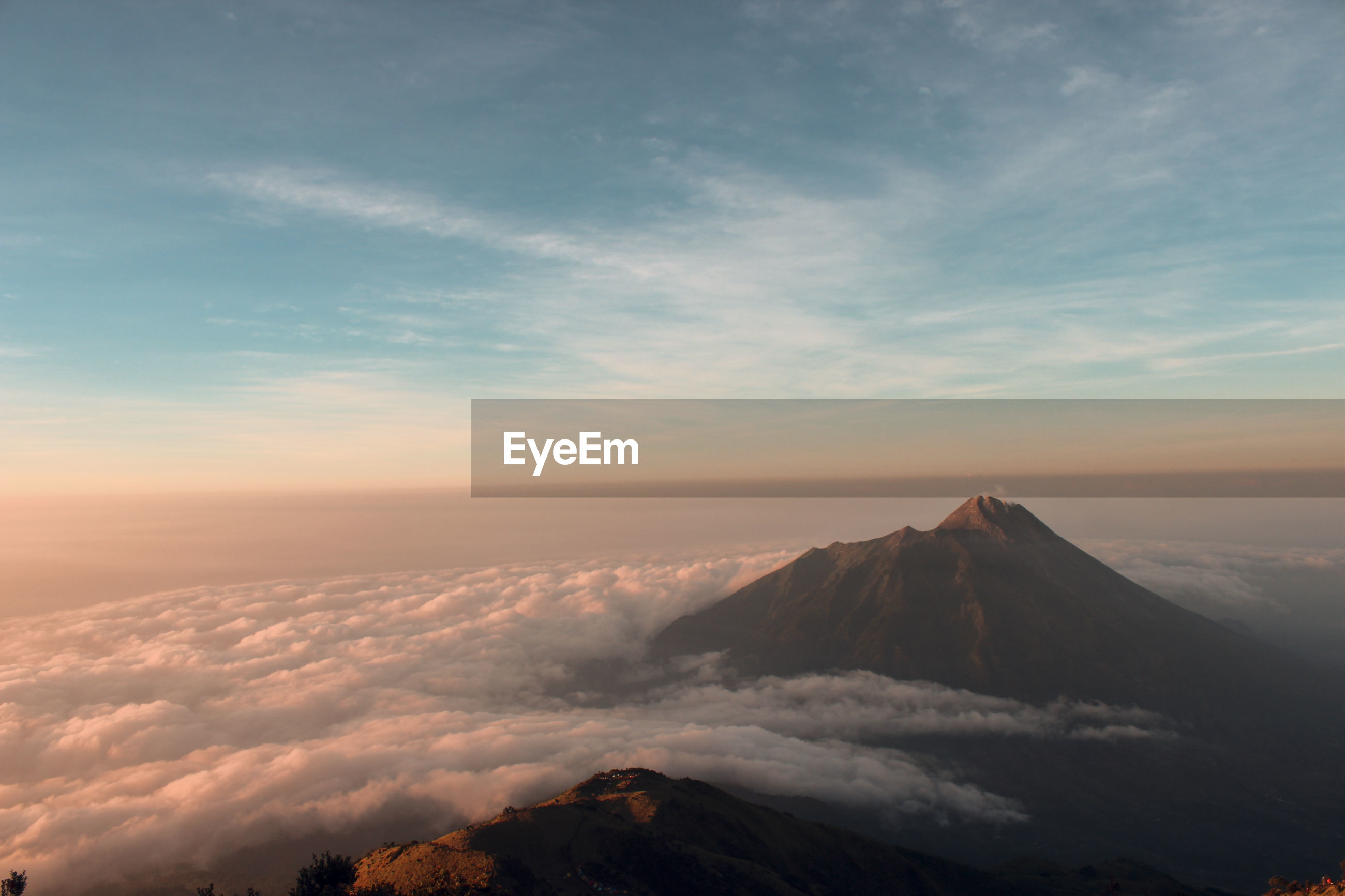Aerial view of majestic mountains against sky during sunset