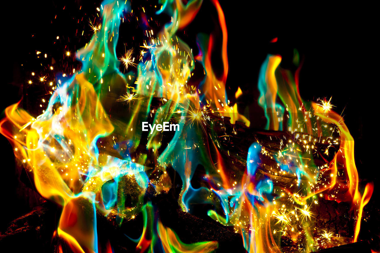 no people, motion, night, burning, fire, heat - temperature, fire - natural phenomenon, flame, multi colored, nature, glowing, illuminated, orange color, pattern, black background, close-up, long exposure, abstract, bonfire, yellow