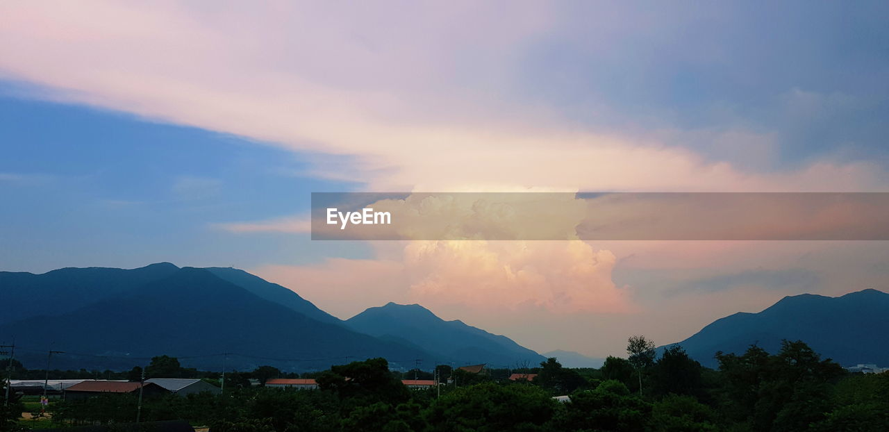 mountain, sky, cloud - sky, architecture, built structure, mountain range, scenics - nature, building, building exterior, beauty in nature, nature, no people, tree, sunset, city, house, plant, environment, residential district, outdoors, mountain peak, townscape, range
