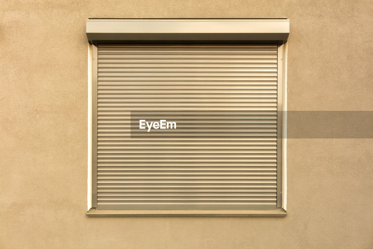 pattern, no people, architecture, built structure, wall - building feature, window, air duct, closed, close-up, day, building exterior, backgrounds, wall, shape, geometric shape, textured, metal, rectangle, security