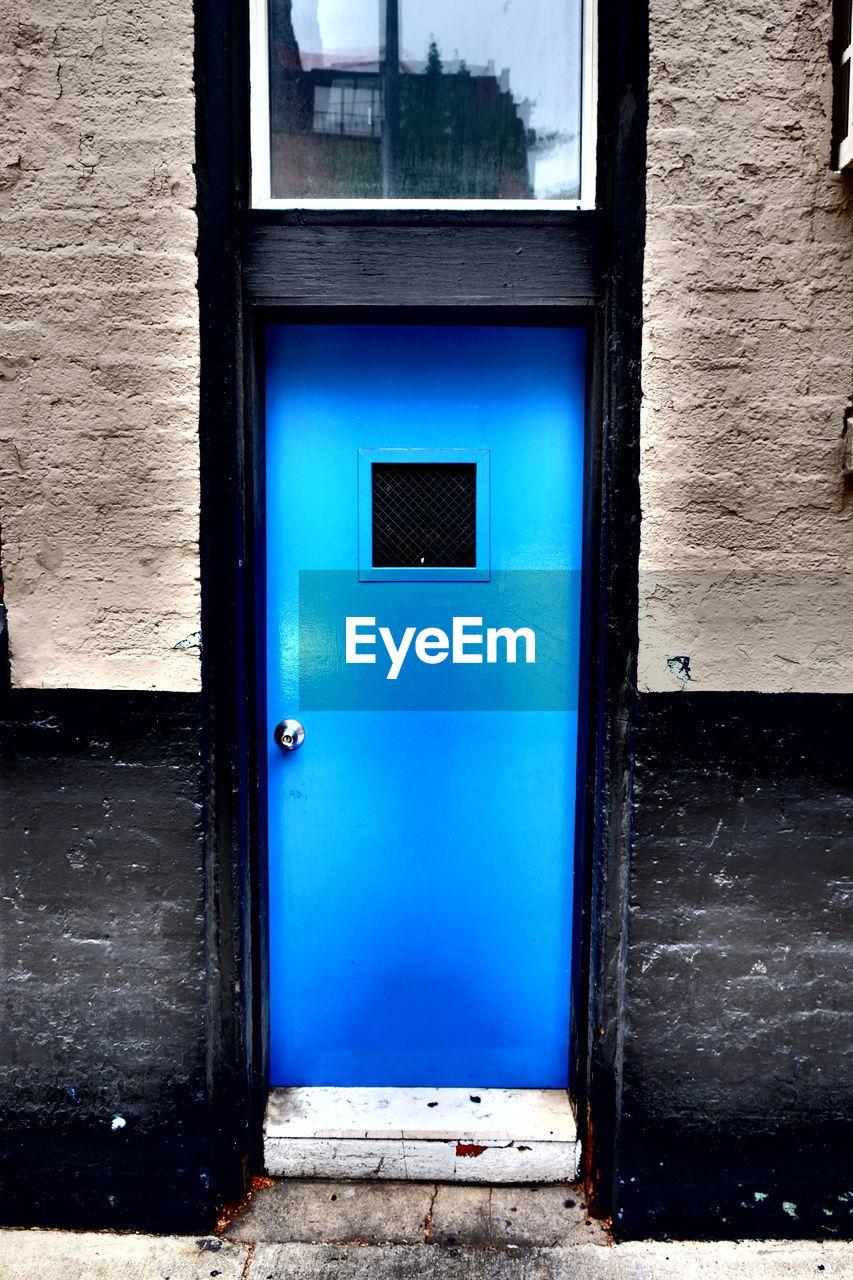 CLOSE-UP OF BLUE WINDOW