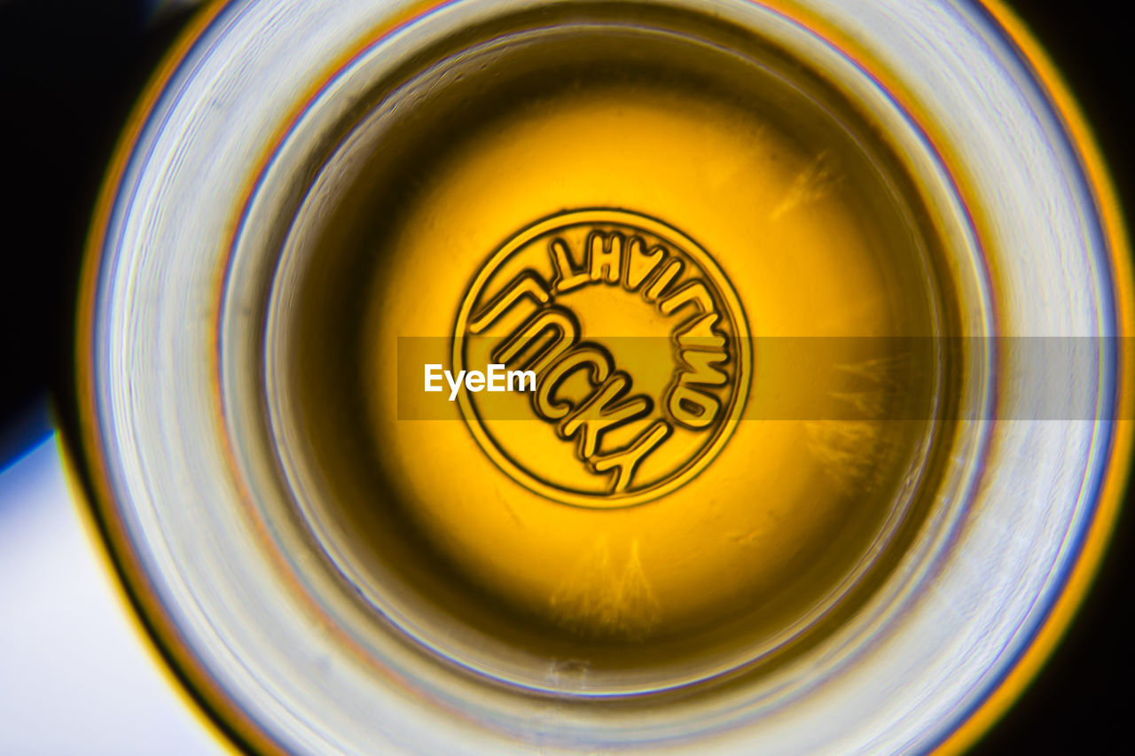close-up, still life, food and drink, indoors, drink, refreshment, no people, directly above, yellow, finance, text, circle, geometric shape, shape, high angle view, currency, container, business, coin, selective focus, crockery
