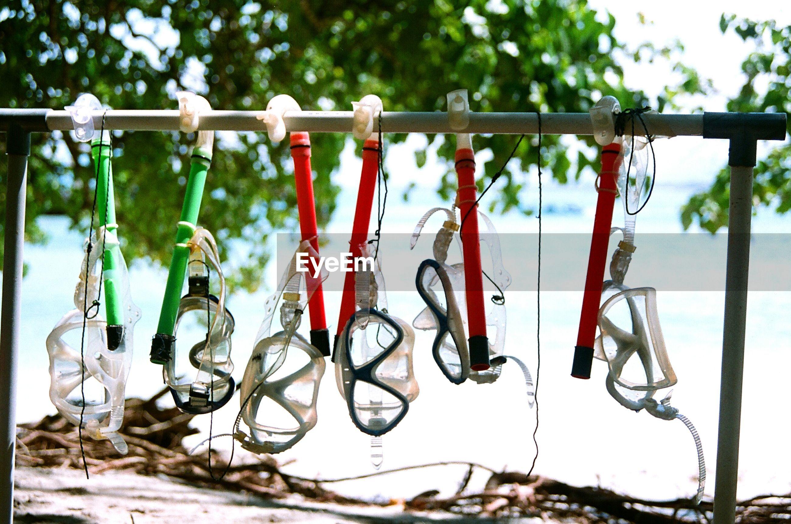 Close-up of snorkel hanging on metal