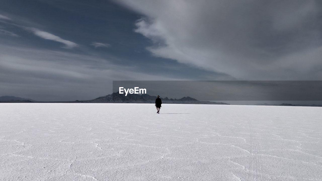 Rear view of person walking on bonneville salt flats