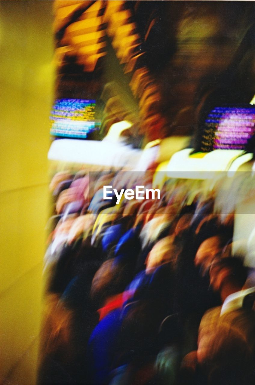 blurred motion, multi colored, real people, motion, indoors, illuminated, large group of people, night, close-up, people