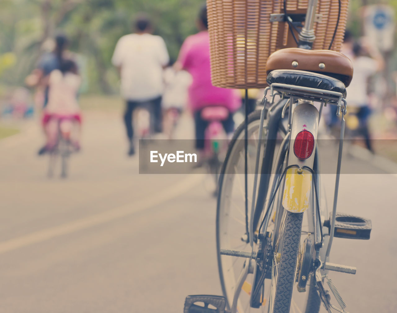 CLOSE-UP OF BICYCLE ON ROAD WITH CITY IN BACKGROUND