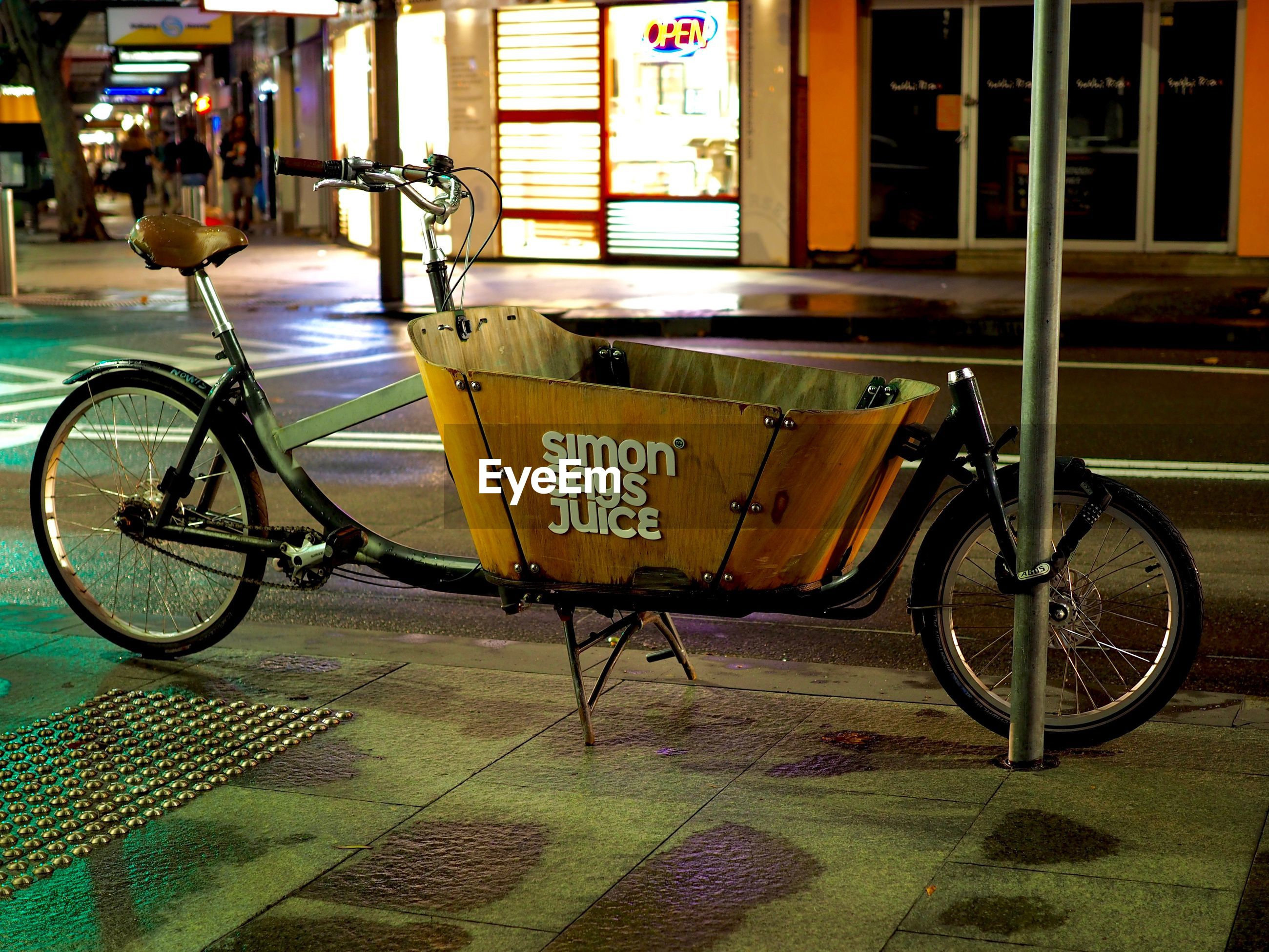transportation, mode of transport, bicycle, text, street, land vehicle, architecture, stationary, outdoors, built structure, city, day, building exterior, no people