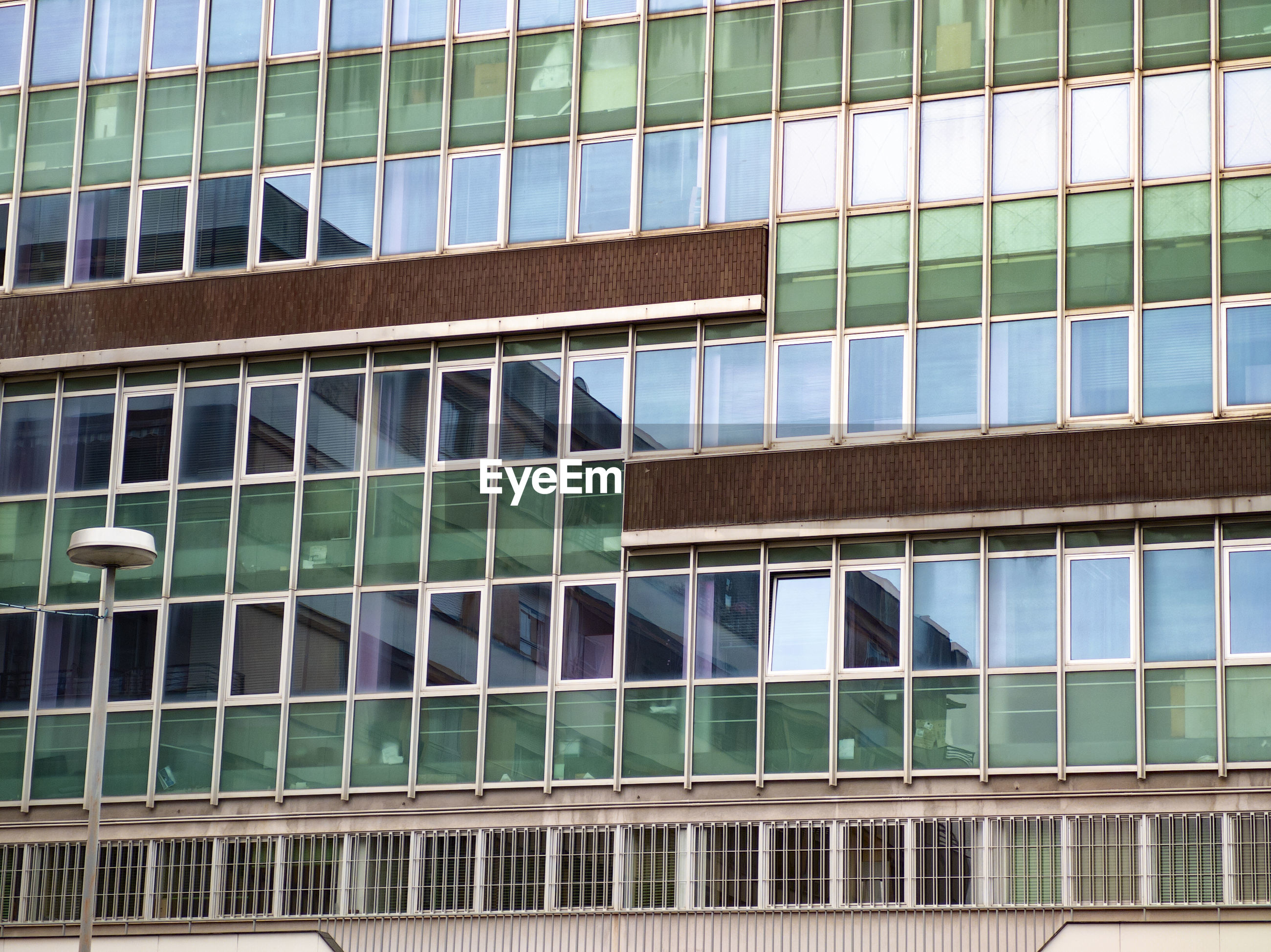 Financial and banking building with windows and urban reflection