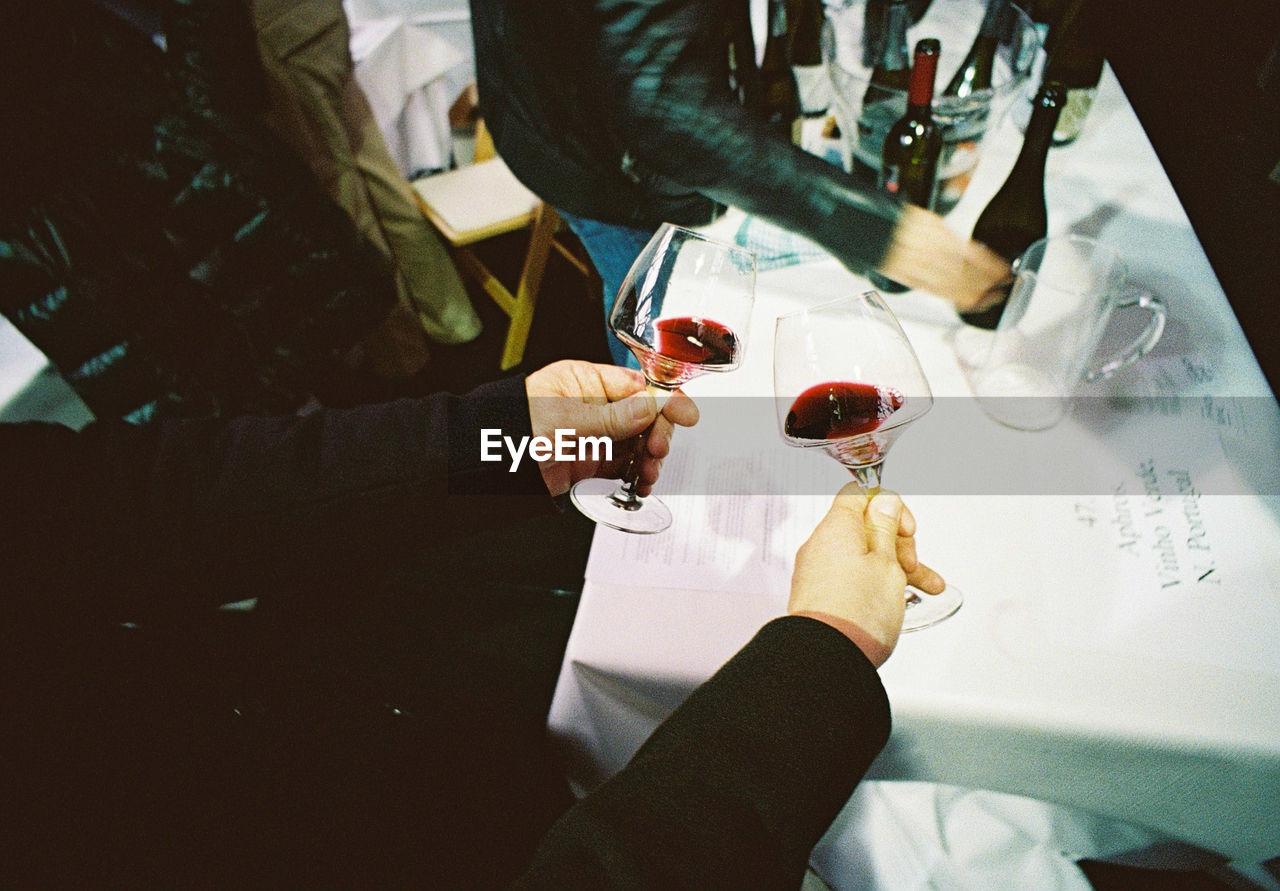 People Having Red Wine