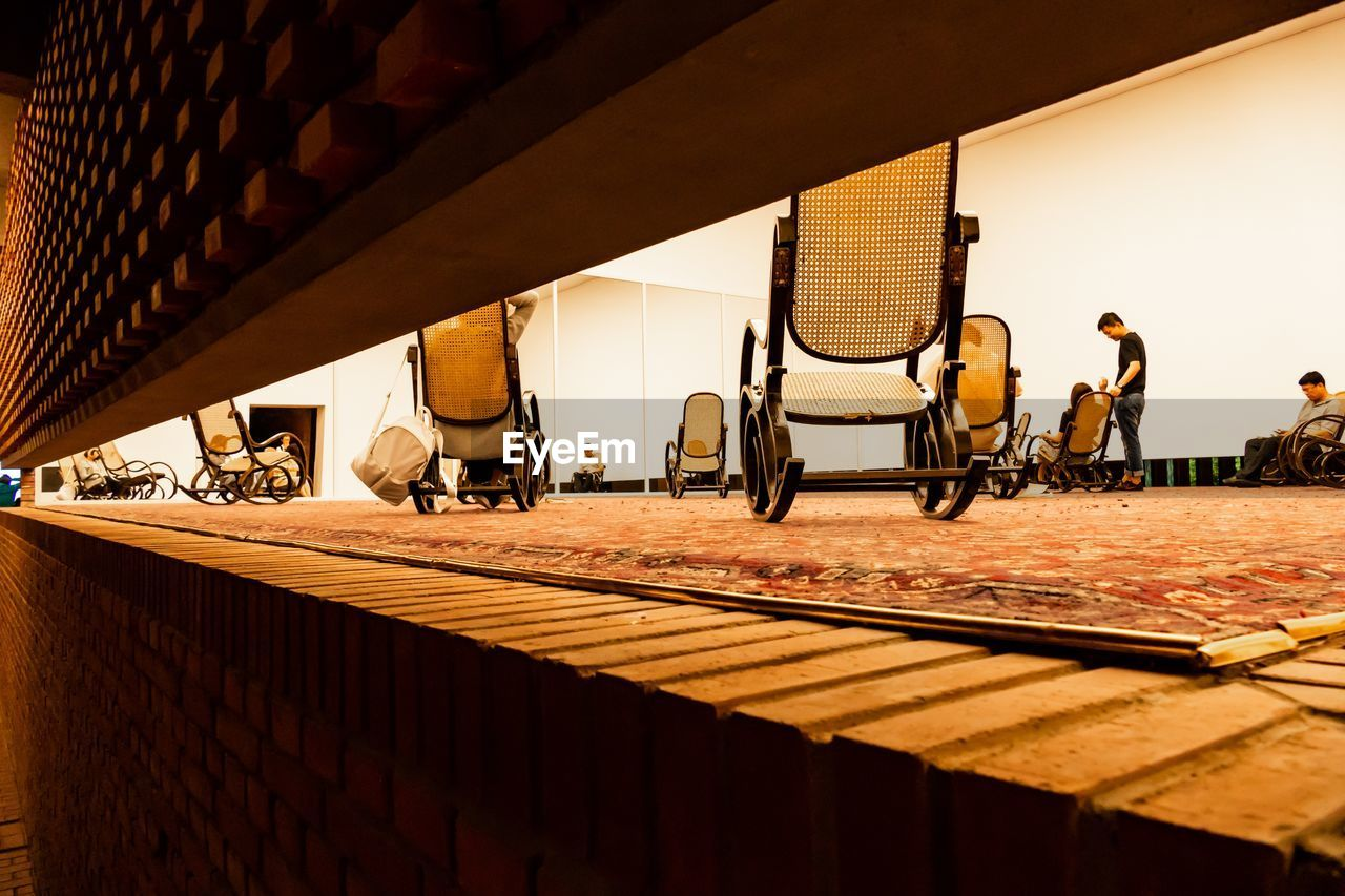 Rocking chairs on floor in building