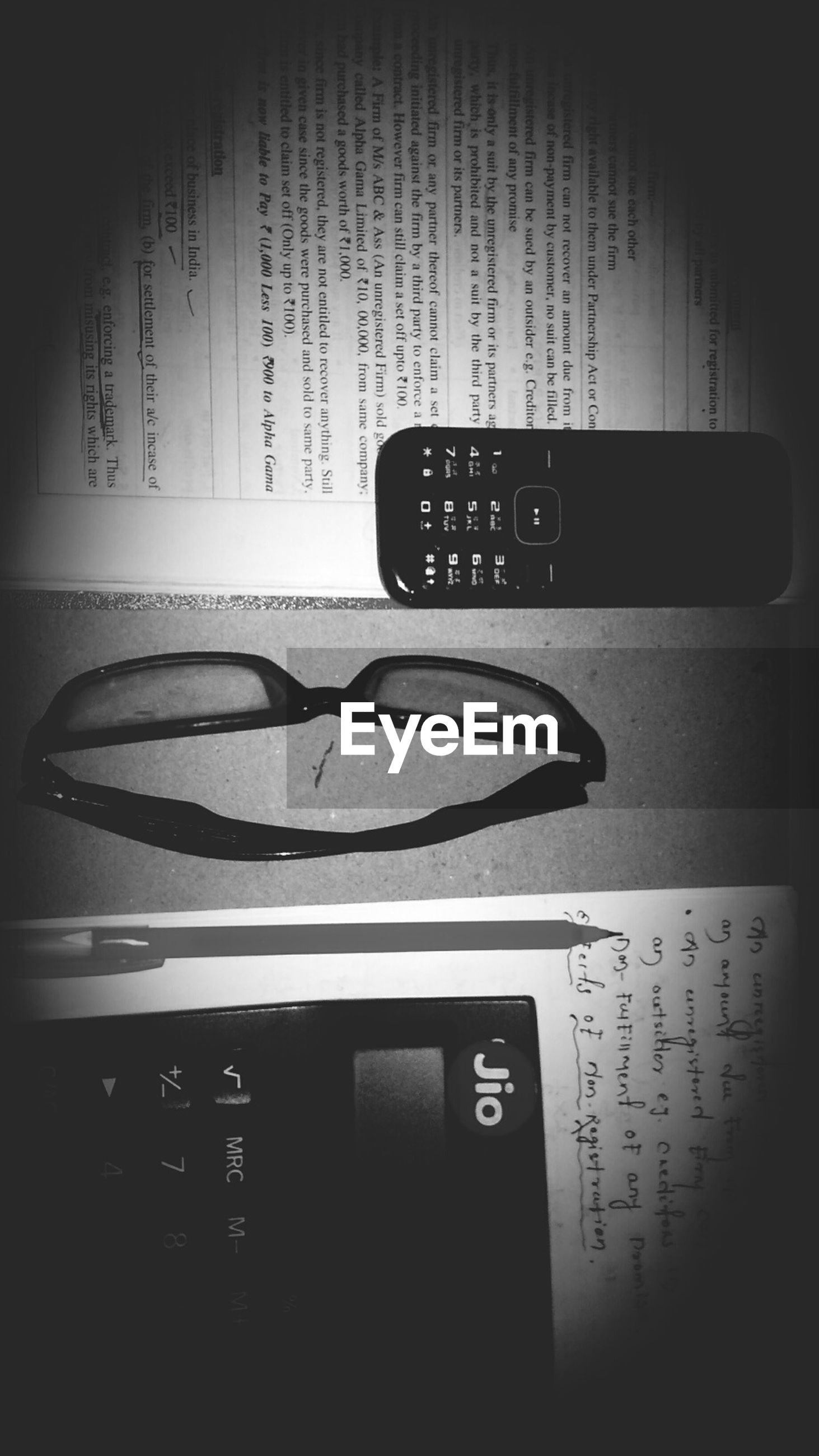 text, indoors, communication, paper, no people, eyeglasses, technology, close-up, vignette, day
