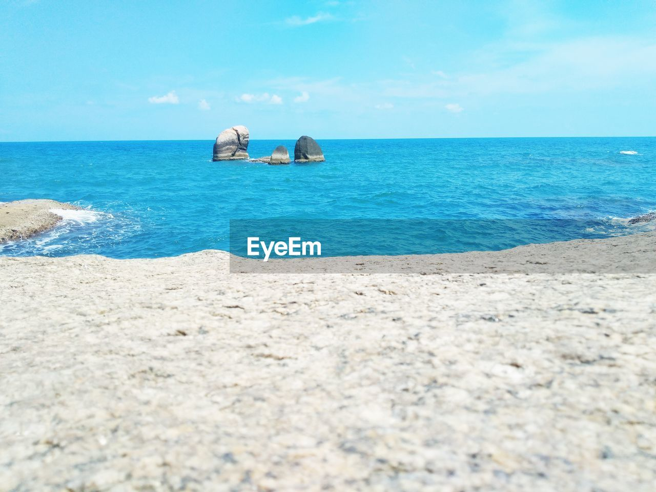 sea, horizon, water, horizon over water, sky, beauty in nature, land, scenics - nature, beach, tranquility, tranquil scene, nature, day, rock, blue, idyllic, rock - object, no people, solid, outdoors