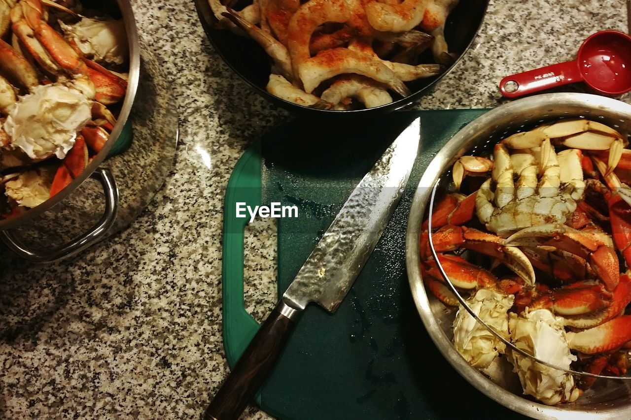 High Angle View Of Seafood In Containers On Table