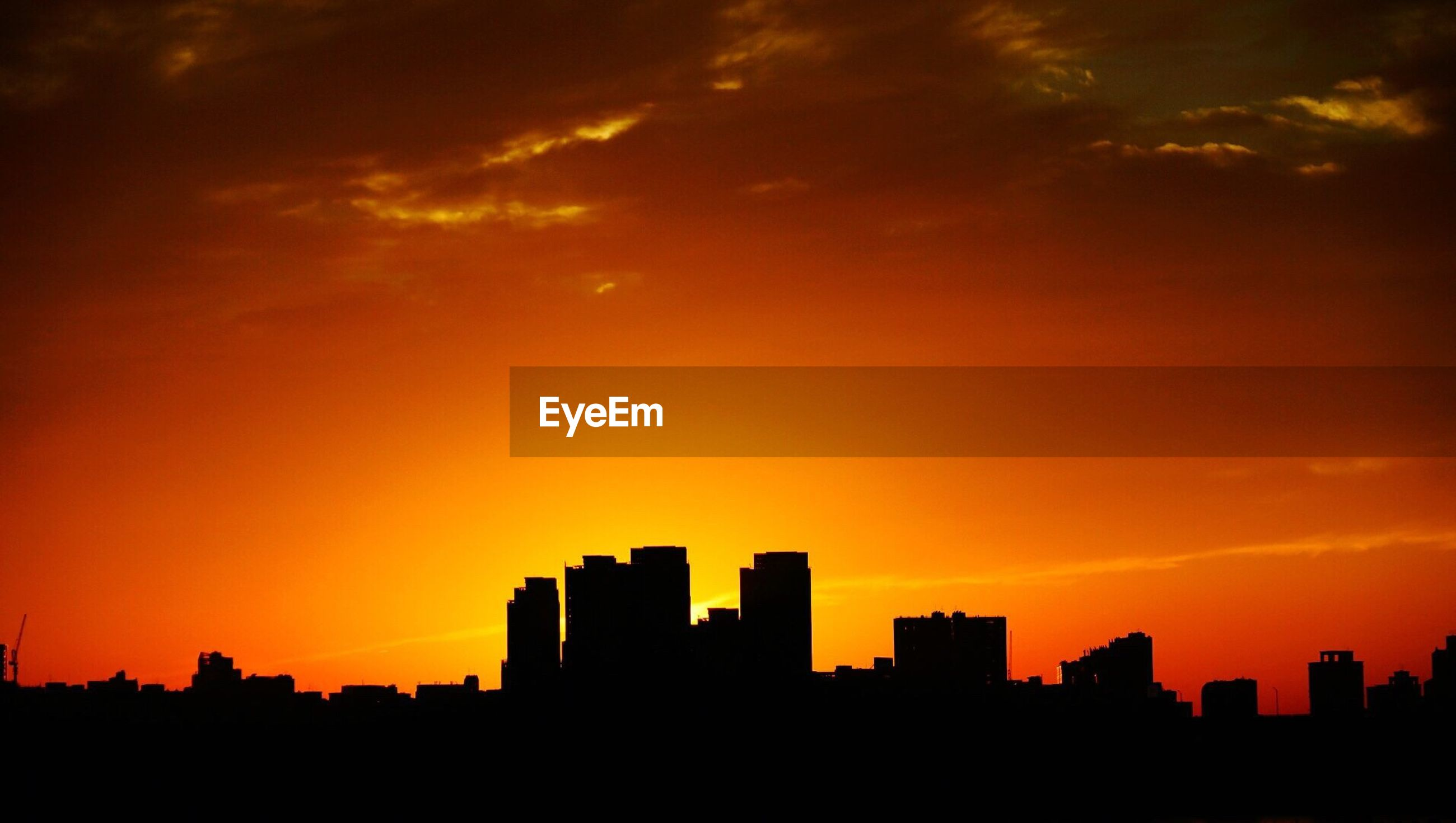 sunset, silhouette, orange color, building exterior, architecture, city, built structure, sky, cityscape, skyscraper, scenics, beauty in nature, sun, cloud - sky, skyline, romantic sky, urban skyline, dramatic sky, outline, dark