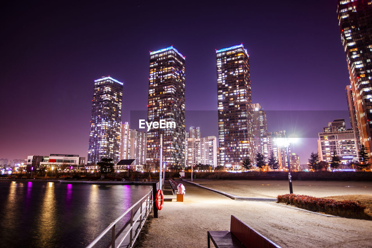 architecture, building exterior, illuminated, night, city, built structure, sky, building, office building exterior, skyscraper, water, nature, cityscape, urban skyline, clear sky, tall - high, tower, landscape, office, modern, no people, outdoors, financial district, nightlife