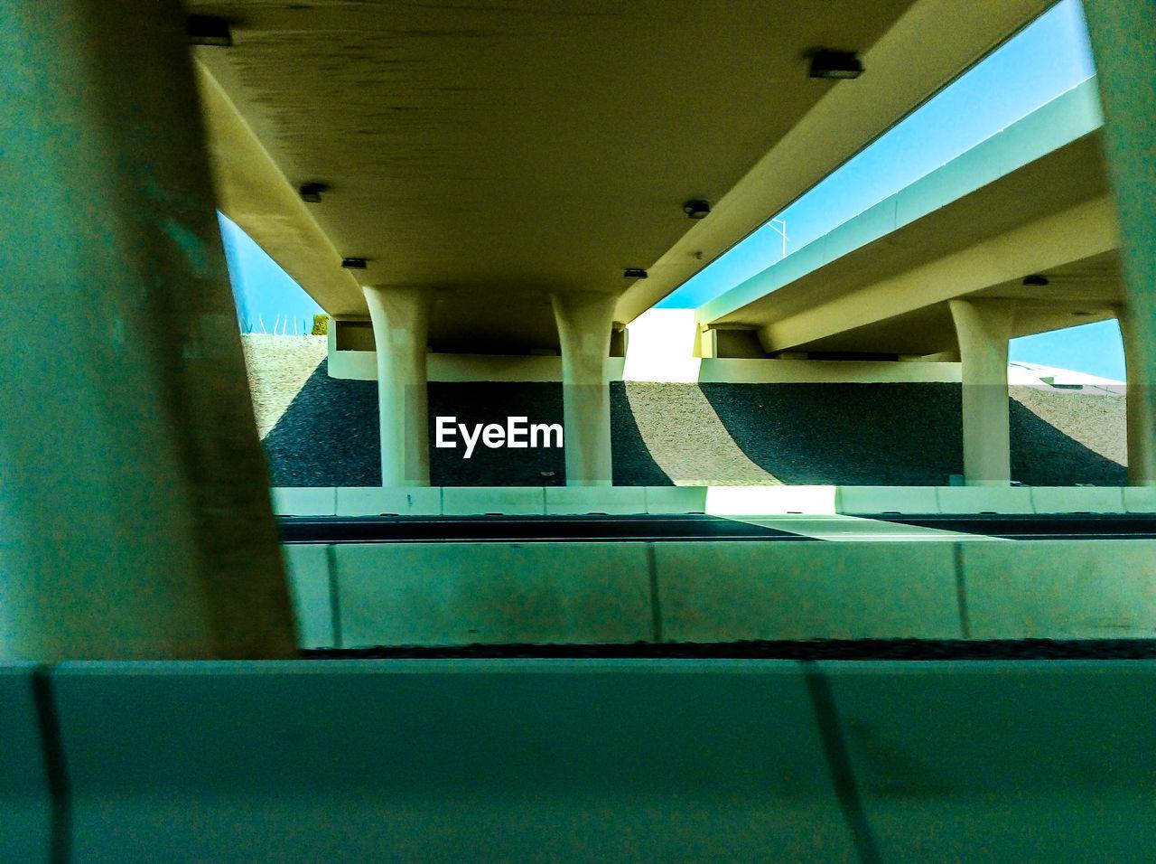 Road Under Bridge On Sunny Day
