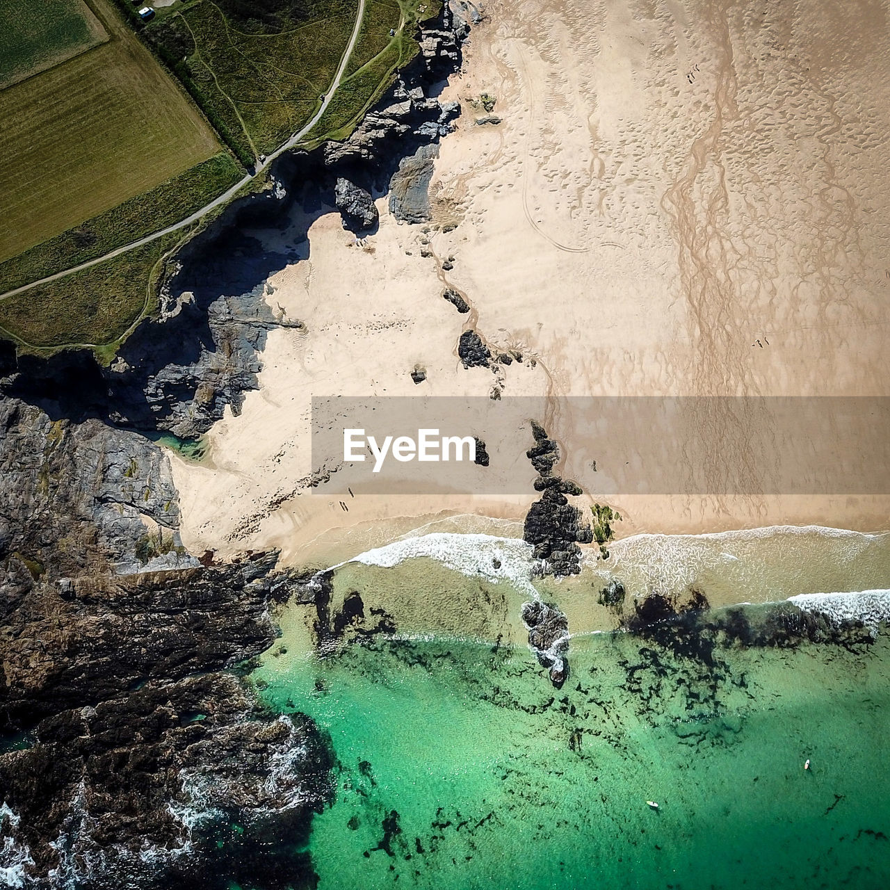 HIGH ANGLE VIEW OF SEA SHORE ON LAND