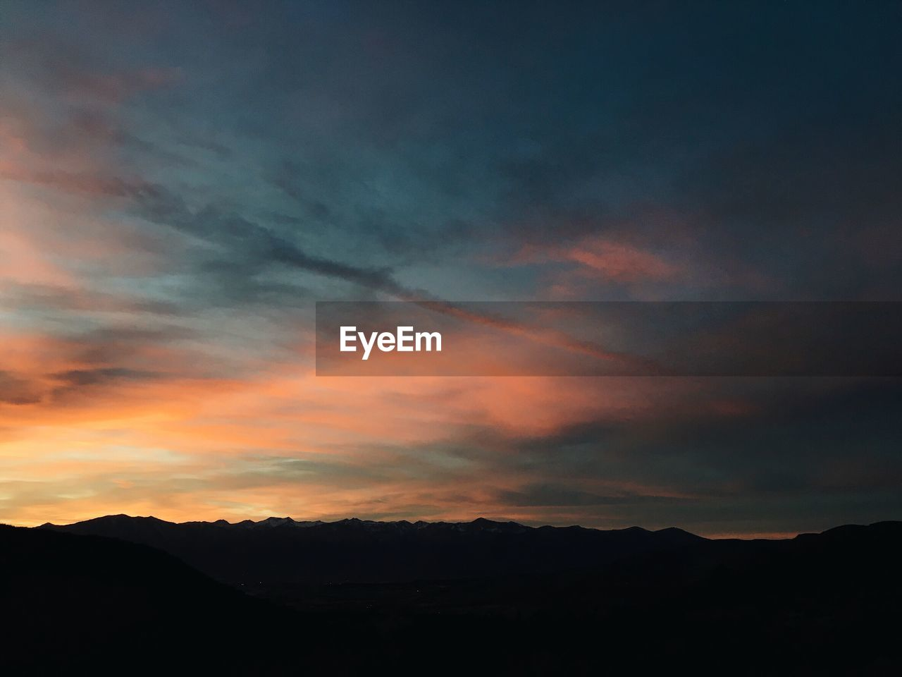 sky, cloud - sky, sunset, beauty in nature, tranquility, tranquil scene, scenics - nature, silhouette, mountain, nature, no people, environment, idyllic, non-urban scene, orange color, mountain range, dramatic sky, landscape, outdoors, low angle view, dark