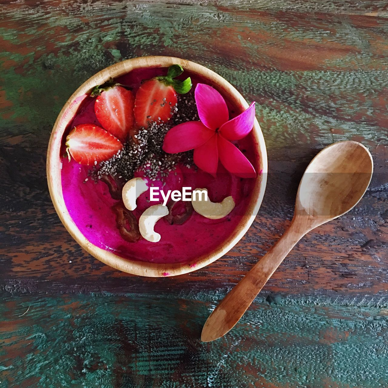 food and drink, food, healthy eating, freshness, table, wood - material, bowl, wellbeing, spoon, kitchen utensil, still life, indoors, fruit, eating utensil, directly above, no people, high angle view, pink color, ready-to-eat, close-up, wooden spoon, purple