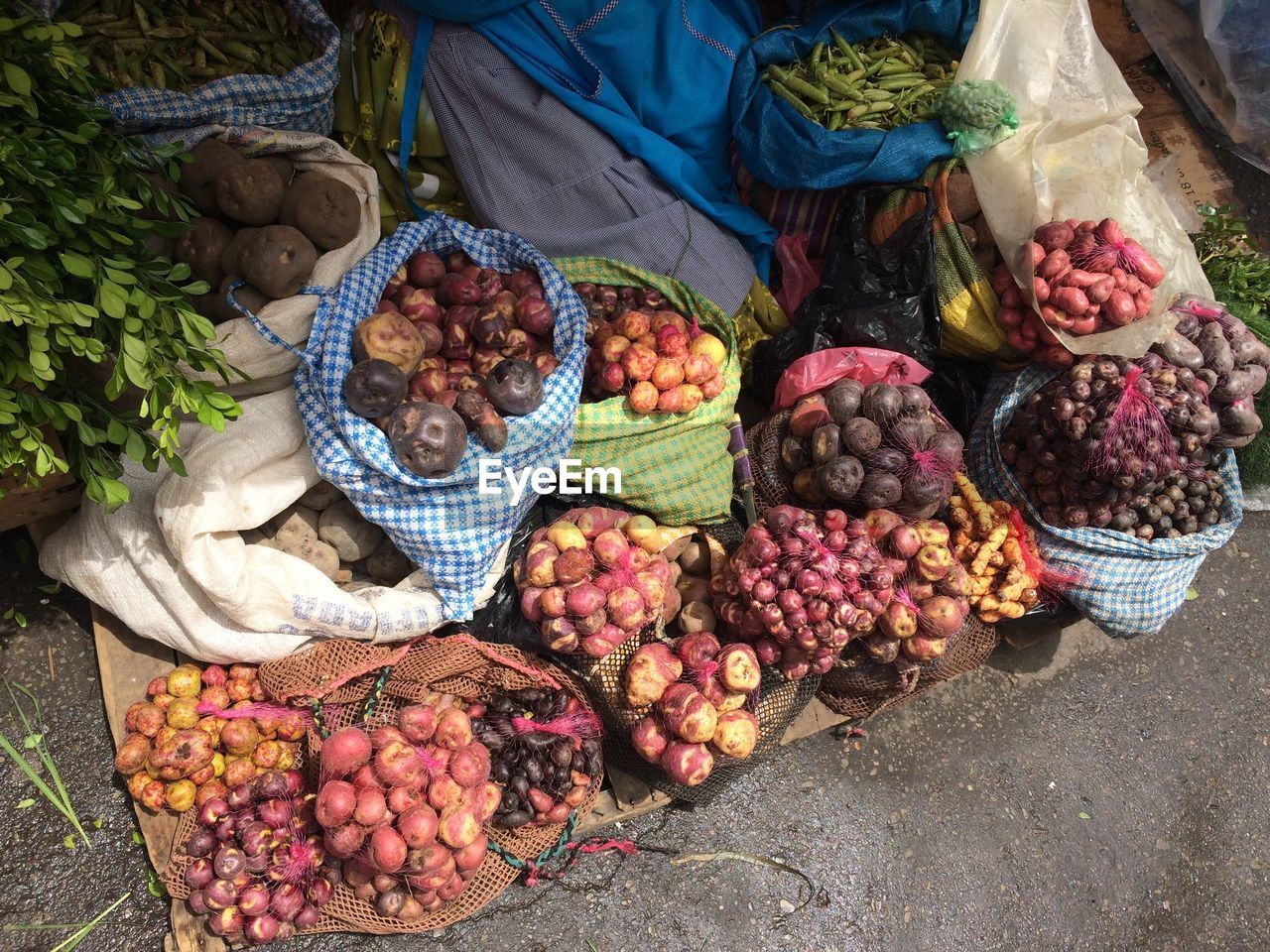 variation, basket, choice, food and drink, freshness, high angle view, vegetable, food, large group of objects, day, for sale, outdoors, healthy eating, market stall, abundance, retail, market, grape, fruit, no people, common beet