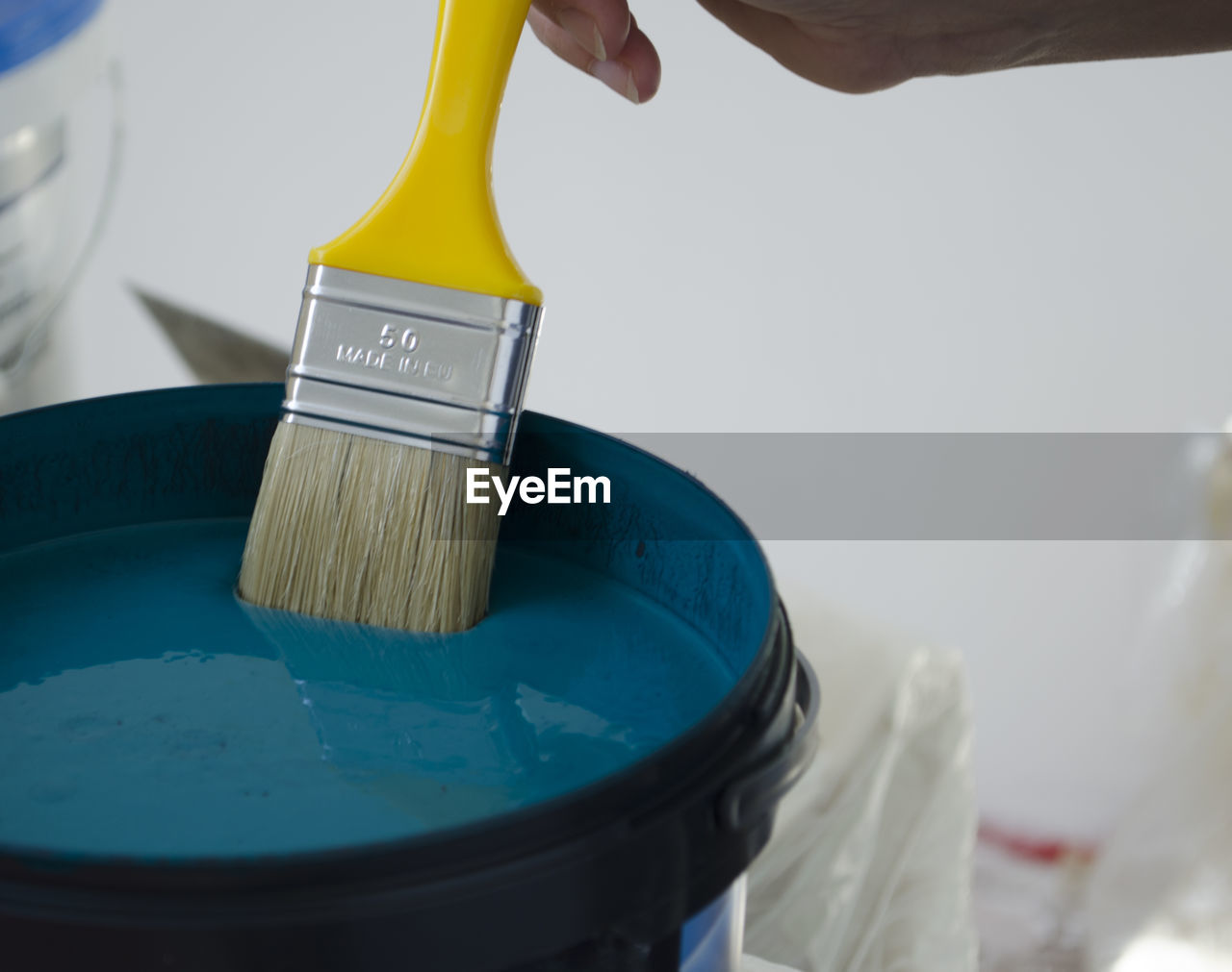 Close-up of brush in paint