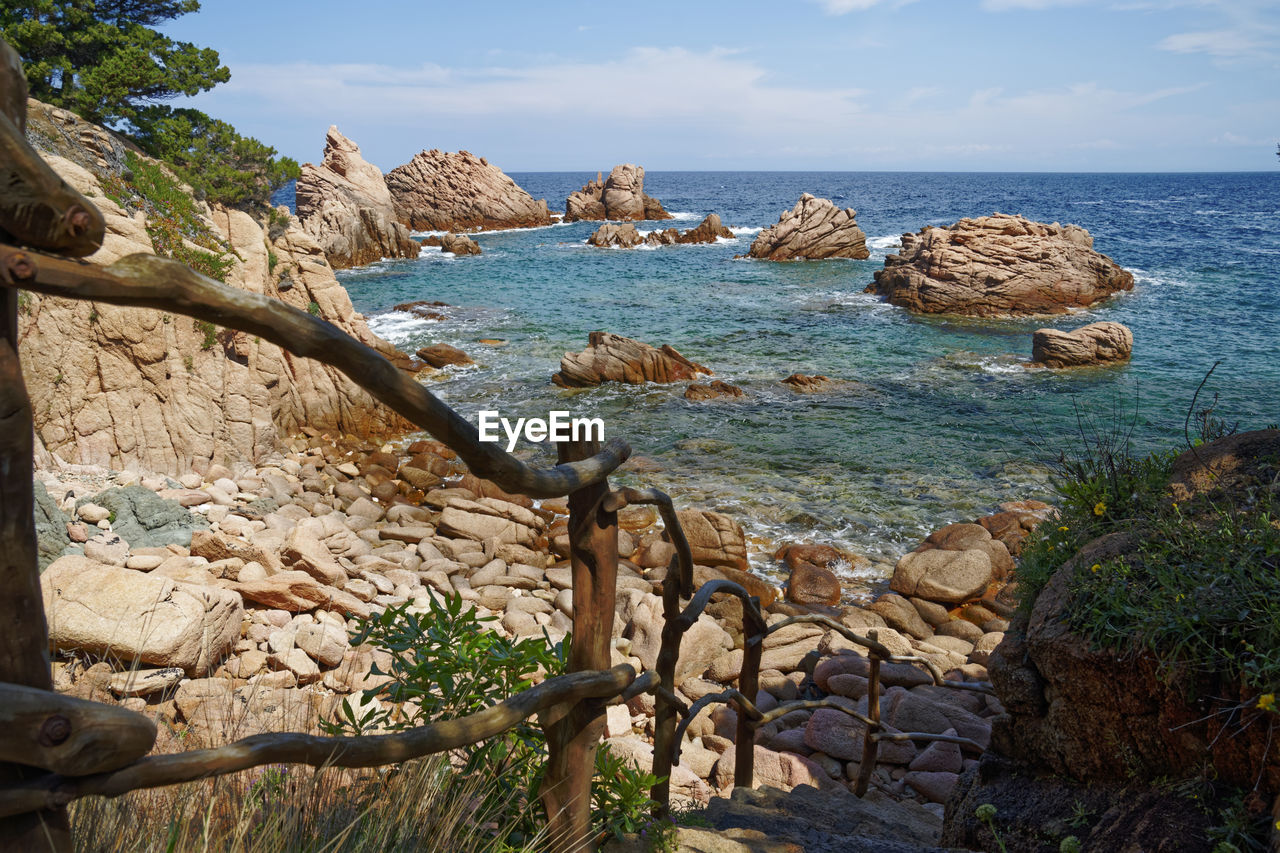 sea, water, sky, rock, scenics - nature, horizon over water, horizon, solid, beauty in nature, rock - object, land, day, tranquil scene, no people, nature, tranquility, beach, plant, rock formation, outdoors