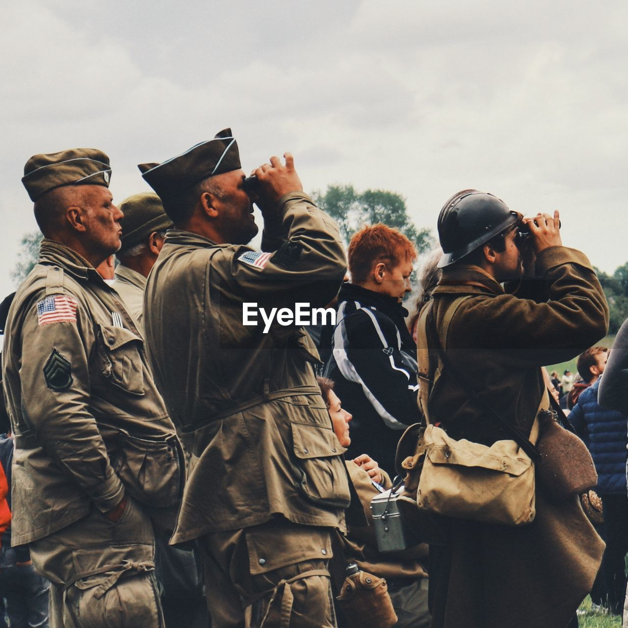 group of people, clothing, real people, togetherness, day, men, people, uniform, friendship, sky, military, group, standing, medium group of people, government, nature, lifestyles, outdoors, young men, military uniform, warm clothing