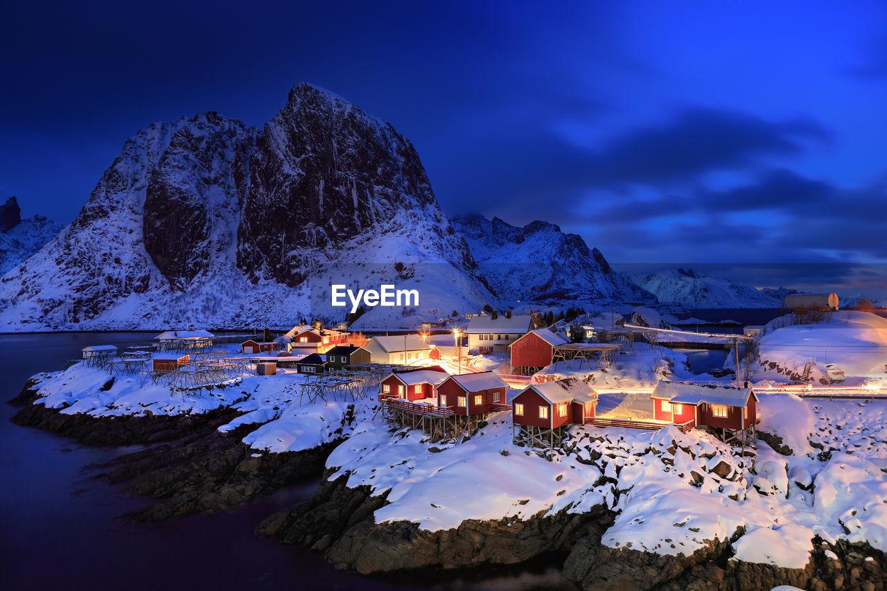 Illuminated Fishing Village At Lofoten Island During Winter