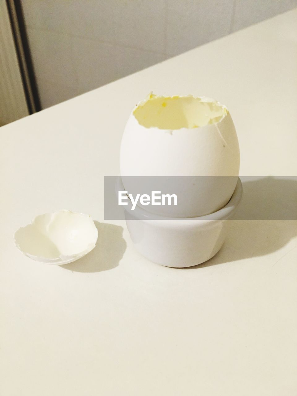 egg, food and drink, egg yolk, boiled egg, white color, healthy eating, food, indoors, eggcup, eggshell, breakfast, table, freshness, no people, yellow, boiled, close-up, day