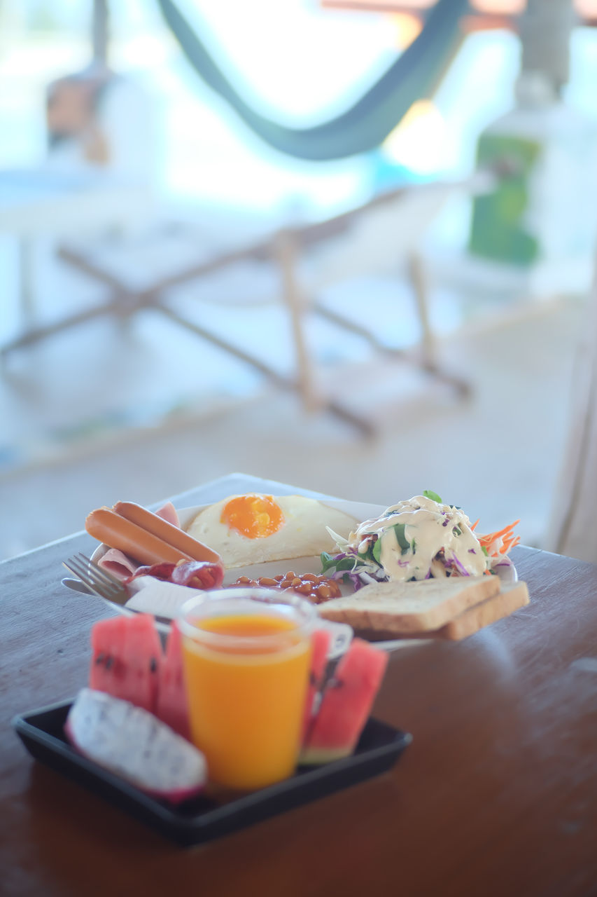 food and drink, food, healthy eating, table, wellbeing, freshness, ready-to-eat, meal, breakfast, serving size, no people, still life, egg, plate, indoors, close-up, drink, selective focus, household equipment, focus on foreground, fried egg, eggcup, glass, tray, japanese food, temptation