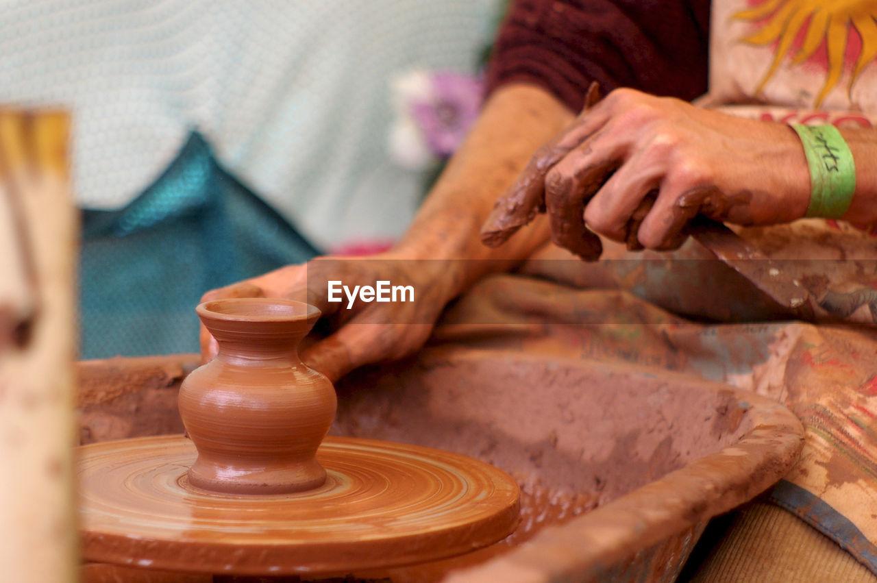Woman sculpting clay